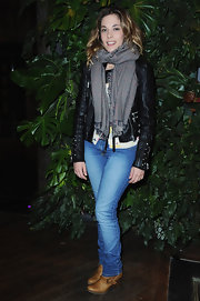 Alysson Paradis looked casual chic in a pair of wedged cognac boots. She wore the boots under light denim jeans.
