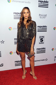 Dania Ramirez amped up the shine with a pair of strappy gold heels by Jimmy Choo.