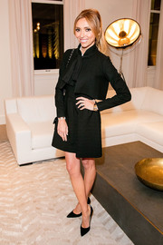 Giuliana Rancic was conservative and classy in a black skirt suit at the Restoration Hardware opening in Chicago.
