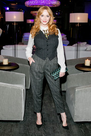 As if her plaids and stripes weren't enough, Christina Hendricks accessorized with a green and black printed clutch.