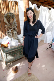Jessica Pare was casual-chic in a navy day dress with bib detail and a drawstring waist at the Retreat Palm Springs event.