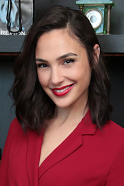 Gal Gadot matched her lipstick to her dress.