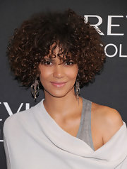 Halle Berry kept her makeup minimal and added just a soft sweep of a pale icy pink lipstick.