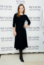 Olivia Wilde was low-key in a navy sweater dress by The Row during Revlon's New Age Defying collection launch.