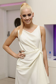 Kimberly Wyatt arrived at the Revolution Gala Night wearing her platinum hair in sleek high wrapped ponytail.