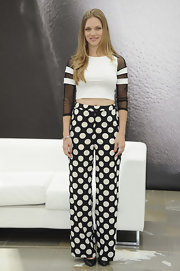 Tracy Spiridakos rocked a white crop top with black mesh sleeves.