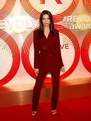 Emily Ratajkowski opted for a belted wine-red pantsuit by L'Academie when she attended the #REVOLVEawards.