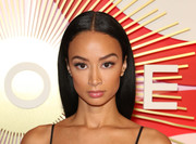 Draya Michele attended the #REVOLVEawards wearing a sleek center-parted hairstyle.