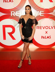Shay Mitchell styled her dress with strappy gold heels.