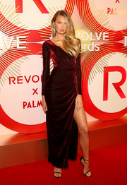 Romee Strijd made a sultry choice with this red velvet wrap gown for the #REVOLVEawards.