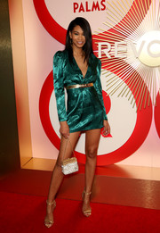 Chanel Iman showed off her legs in an emerald satin mini dress by Lovers + Friends at the #REVOLVEawards.