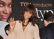 Tyra Banks paired her nude ensemble with a chunky bronze statement necklace.