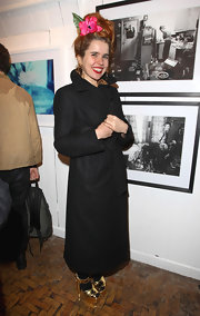 Paloma Faith kept covered up in a long black wool trench coat.