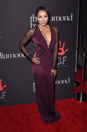 Kat Graham sheathed her fabulous figure in a plum-colored Pamela Rolland gown with black mesh sleeves and a deep-V neckline for the Diamond Ball.