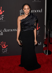 Tia Mowry worked a black Edward Arsouni one-shoulder gown with an architectural bodice during the Diamond Ball.