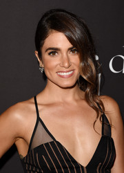 Nikki Reed looked super pretty wearing this very loose side updo with wavy tendrils during the Diamond Ball.