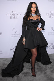 Rihanna finished off her look with a pair of black triple-strap heels by Giuseppe Zanotti.