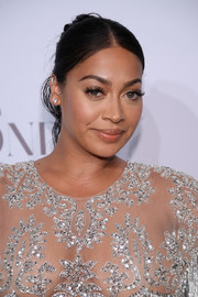 La La Anthony styled her hair into a twisted bun with wavy tendrils for the Diamond Ball.