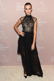 Josephine Skriver went for goth-inspired elegance in a tiered black lace gown by Le Lis Blanc at the 2018 Diamond Ball.