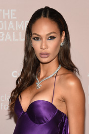 Joan Smalls wore her hair in a wavy style with a center braid at the 2018 Diamond Ball.