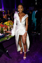 Normani complemented her frock with white ankle-strap sandals.