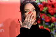 Rihanna showed off her red mani while blowing kisses at the 2019 Diamond Ball.