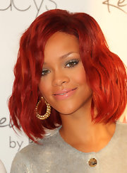 Rihanna launched her new fragrance wearing nude lipstick. The subdued color was the perfect match for her feminine look.