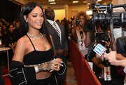 Rihanna showed off her elaborate henna-style tribal tattoo during the Rogue Man fragrance launch.