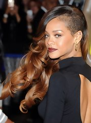 Rihanna is not one to shy away from funky trends. The singer sported gorgeous long curls with a trendy partially shaved head.