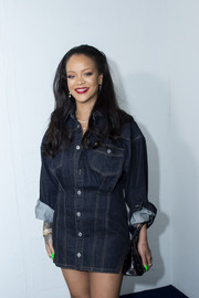 Rihanna visited the Fenty pop-up store in Paris wearing a denim mini dress from her collection.