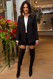 Alessandra Ambrosio schooled us on how to look hot in a skirt suit when she wore this black jacket and mini skirt ensemble to the Rimowa flagship store opening in London.