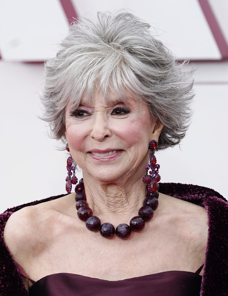 Rita Moreno Layered Razor Cut [smile,skin,lip,chin,eyebrow,lipstick,iris,street fashion,dress,eyelash,jewellery,hair,hair,hair coloring,smile,skin,lip,california,los angeles,annual academy awards,hair,hair coloring,human hair color,layered hair,blond,bangs,color,purple,long hair / m,jewellery]