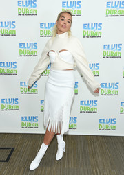 Rita Ora got playful in a white peekaboo crop-top by Dion Lee for her visit to 'The Elvis Duran Z100 Morning Show.'
