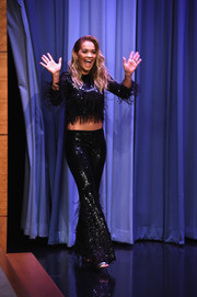Rita Ora appeared on 'Jimmy Fallon' rocking a sequined and feathered crop-top.