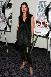 Jill Hennessy made a statement in metallic leopard print leggings teamed with a black fur vest.