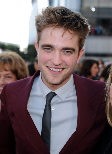 Robert Pattinson Messy Cut [the twilight saga: eclipse,hair,facial expression,hairstyle,premiere,eyebrow,blond,forehead,suit,smile,white-collar worker,arrivals,robert pattinson,nokia theatre l.a. live,los angeles,california,summit entertainment,premiere,premiere,los angeles film festival]