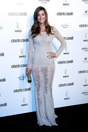 Malena Costa flaunted her figure in a teasing embroidered gown at Roberto Cavalli's boutique opening in Madrid.