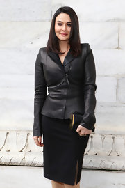 Preity Zinta went to see the Roberto Cavalli fashion show wearing a black ensemble and leather purse.