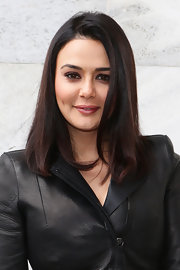 Preity Zinta wore her healthy-looking locks down at the Roberto Cavalli fashion show.