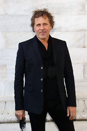 Renzo Rosso oozed style in his all-black ensemble, consisting of a blazer, shirt, pants, and fringed scarf.
