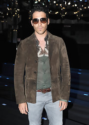 Miguel Angel Silvestre's brown suede jacket added tons of style to his ensemble.