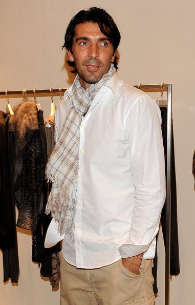 What stylin' Italian man could leave home without his lightweight fringed scarf? Gianluigi wears a gauzy checked number.