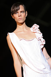 Freja showed off a wet bun with side swept bangs while walking the runway at the Roberto Cavalli show.
