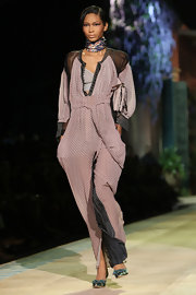 Chnael wore a lilac print jumpsuit with sheer insets for walking the Roberto Cavalli runway.