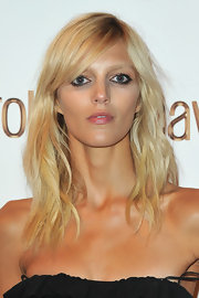 Anja Rubik complemented her sexy dress with a beachy layered cut when she attended the Roberto Cavalli party.