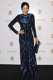 Ana Araujo shimmered in a sequined blue evening dress at the Roberto Cavalli store launch.