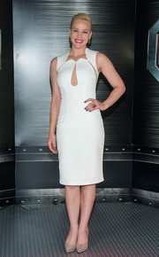 Abbie Cornish chose a sleek white Philip Armstrong dress with sheer cutouts for the 'RoboCop' photocall.