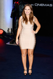 Tanya Burr looked voluptuous in a pale pink bandage dress during the 'Robocop' premiere in London.
