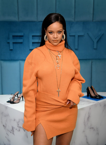 Rihanna attended the launch of Fenty at Bergdorf Goodman wearing multiple cross pendant necklaces.