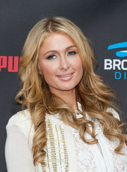 Paris Hilton wore sweet-looking corkscrew curls when she attended the Roc Nation pre-Grammy brunch.